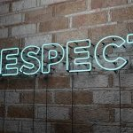 Respect writen on brick wall in neon